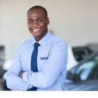Medium african car salesman portrait portrait of happy african car salesman in showroom stock image csp26524066